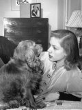 Actress Lauren Bacall Chatting with Her Cocker Spaniel Dog in Her Suite at Gotham Hotel Premium Photographic Print by Nina Leen