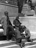 Shoeshine Boys Working on Businessmen's shoes on Front Steps of the New York Public Library Premium Photographic Print by Alfred Eisenstaedt