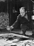 Jackson Pollock Dribbling Sand on Painting While Working in His Studio Premium Photographic Print by Martha Holmes