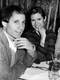 Paul Simon with Girlfriend, Carrie Fisher, at Party for Fisher's Dad, Singer Eddie Fisher Premium Photographic Print by David Mcgough
