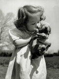 Christina Goldsmith Kissing a Weimaraner Puppy from Her Father's Stock of Weimaraner Hunting Dogs Premium Photographic Print by Bernard Hoffman