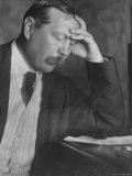 Photo by E. O. Hoppe of Author Sir Arthur Conan Doyle Seated, Eyes Downcast, in Reflective Pose Premium Photographic Print by E O Hoppe