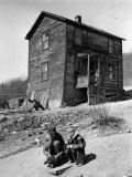 Coal Miner's Boys Playing with Puppy Outside Ramshackle, Two Story House in Dreary Mining Town Premium Photographic Print by Alfred Eisenstaedt