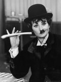 Comedien/Actress Lucille Ball imitating Charlie Chaplin on her New Year's TV show Lámina fotográfica de primera calidad por Ralph Crane