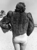 Model Wearing Fur Jacket over Bathing Suit During Walk on Miami's Beac Fotoprint van Alfred Eisenstaedt