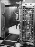 Bank Employee Selecting a Safety Deposit Box for a Customer Inside Vault Area Photographic Print by Bob Gomel
