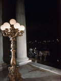 Bronze Torchere Stands Vigil at the 5th Avenue Entrance of the Plaza Hotel Premium Photographic Print by Dmitri Kessel