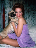 - david-mcgough-actress-eileen-fulton-sitting-on-her-bed-wrapped-in-purple-towel-and-holding-her-dog