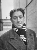 Actor Alec Guinness Dangling Cigarette from His Lips, on Movie Lot Premium Photographic Print by Alfred Eisenstaedt