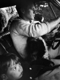 Sen. Robert Kennedy Driving His Car with Pet Springer Spaniel over His Lap and Son Max Beside Him Premium Photographic Print by Bill Eppridge