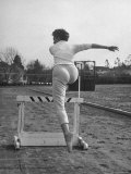 Dancer and Actress Sheree North Leaping over a Hurdle at Beverly Hills High School Track Premium Photographic Print by Loomis Dean