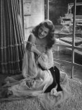 "Actress Rita Hayworth Wearing Nude Souffle Negligee in movie ""Gilda"" Premium Photographic Print by Bob Landry"