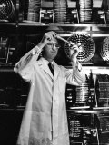 University of Pittsburgh Dr. Jonas Salk Examine Test Tube of Polio Virus Used to make Polio Vaccine Premium Photographic Print by Alfred Eisenstaedt