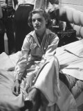 "Actress Lauren Bacall Sitting on Bed During Break on the Set of the Movie ""Young Man with a Horn"" Premium Photographic Print by Alfred Eisenstaedt"