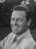 Actor William Holden Smiling for the Camera Premium Photographic Print by Allan Grant