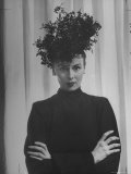 Austine Cassini Standing with Arms Crossed and Wearing Extravagant Hat Premium Photographic Print by Marie Hansen