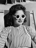 "Model Stephanie Nikashian Sporting Sunglasses with ""Seashell Rims"" While Lounging at Beach Premium Photographic Print by Alfred Eisenstaedt"