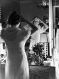 Mrs. Elizabeth Arden Graham Viewing Herself in Bedroom Mirror Premium Photographic Print by Alfred Eisenstaedt