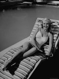 Actress Marie McDonald Posing in Chair by Swimming Pool Premium Photographic Print by Martha Holmes