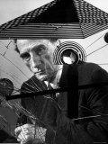 Marcel Duchamp Sitting Behind Example of Dada Art Metal Print by Allan Grant