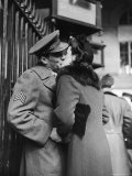 Soldier Kissing His Girlfriend While Saying Goodbye in Pennsylvania Station Premium Photographic Print by Alfred Eisenstaedt