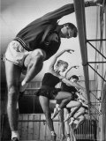 Olympic High Jumper Walter Davis Doing Ballet Exercises in Class of Women Dancers Premium Photographic Print by John Dominis