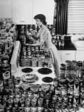 Hundreds of Cans of Assorted Products Stacked Neatly on Display in Modern Kitchen Premium Photographic Print by Al Fenn