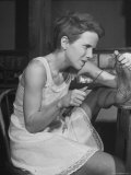 "Actress Julie Harris, Digging Splinter from Foot with Knife in Scene from ""Member of the Wedding"" Premium Photographic Print by Eliot Elisofon"