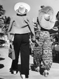 Model Stephanie Nikashian in Cartwheel Straw Hat and Flower Print Turkish Trousers Photographic Print by Alfred Eisenstaedt