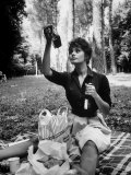 Actress Sophia Loren Examining Contents of Bottle During Location Filming of