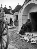 Locals Outside Trulli Homes Made from Limestone Boulders and Feature Conical or Domed Roofs Premium Photographic Print by Alfred Eisenstaedt
