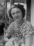 Novelist Marjorie K. Rawlings Holding Her Cat Premium Photographic Print by Nina Leen