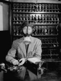Pictures from Money Making Company Brink's Incorporated with Employee Posing in a Gas Mask Photographic Print by Wallace Kirkland