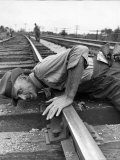 Railroad Section Boss D. D. Pittman Checking to Make Sure New Rail is properly level Premium Photographic Print by Alfred Eisenstaedt