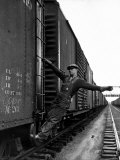 Railroad Brakeman George Christian, Swinging His Arm Horizontally to Signal to Locomotive Engineer Premium Photographic Print by Alfred Eisenstaedt