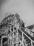 Thrill Seekers at the Top of the Cyclone Roller Coaster at Coney Island Amusement Park Premium Photographic Print by Marie Hansen