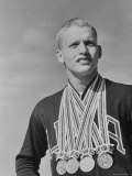 Swimmer Don Schollander Posing with 4 Gold Medals He Won in the Summer Olympics Premium Photographic Print by John Dominis