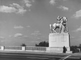 Lone Policeman Standing Beneath Equestrian Statue on Memorial Bridge over the Potomac River Premium Photographic Print by Walker Evans