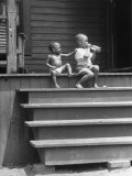 African American Boys at top of Stairs as Older Boy is Drinking Soda and Younger One Reaches for It Premium Photographic Print by Alfred Eisenstaedt