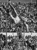 Robert B. Mathias Attempting the Pole Vault at 1952 Olympics Premium Photographic Print by Mark Kauffman