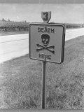 "Skull and Crossbones Surrounded by the Words ""Death Here"" marking fatal car accident Premium Photographic Print by Alfred Eisenstaedt"