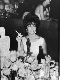 Actress Elizabeth Taylor at Hollywood Party After Winning Oscar, Which is on Table in Front of Her Premium Photographic Print by Allan Grant