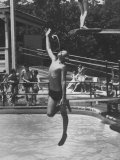 Boy Jumping Into Water and Squirting Water From His Mouth at Same Time at Glen Echo Amusement Park Premium Photographic Print by Mark Kauffman