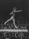 Russian Gymnast Larisa Latynina Competing on the High Beam in the Olympics Premium Photographic Print by John Dominis