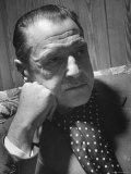 Author Somerset Maugham Sitting on Couch and Leaning Head on Knuckles Premium Photographic Print by Serge Balkin