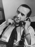 News Commentator, Edward R. Murrow with cigarette in mouth, tie loose, resting in his chair Premium Photographic Print by Lisa Larsen