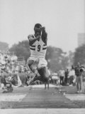 Olympic Broad Jumper Ralph Boston Making His Winning Jump at the Olympic Trials at Downing Stadium Premium Photographic Print by John Dominis