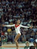 Russian Gymnast Olga Korbut Performing Floor Exercises at Summer Olympics Premium Photographic Print by John Dominis