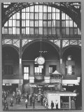 Bustling Interior Showing Digital and Standard Clocks and Ironwork Arches of Penn Station Photographic Print by Walker Evans