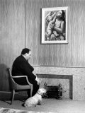 British Born Film Director Posing Beside Fireplace at Home with Pet Sealyham Terrier, Mr. Jenkins Premium Photographic Print by Peter Stackpole